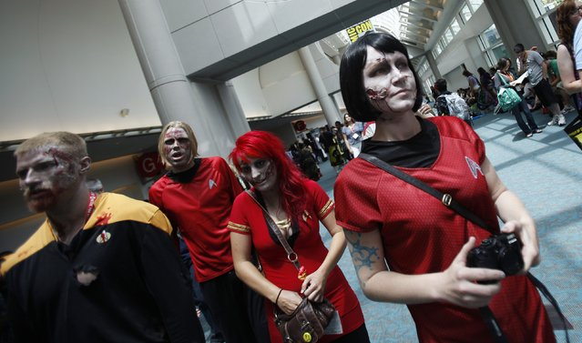 Attendees made-up like zombies walk during the Comic-Con international convention in San Diego, California July 13, 2012. (Photo by Mario Anzuoni/Reuters)