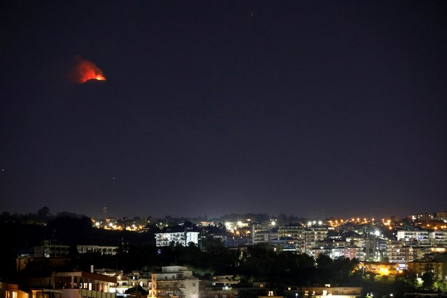 Eruptions from Mount Etna light up the sky during the night in Catania, Italy, December 14, 2020. (Photo by Antonio Parrinello/Reuters)