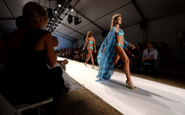 Models walk the runway at the Dolores Cortes. (Photo by Andrew H. Walker/Getty Images for Mercedes-Benz Fashion Week Swim 2014)