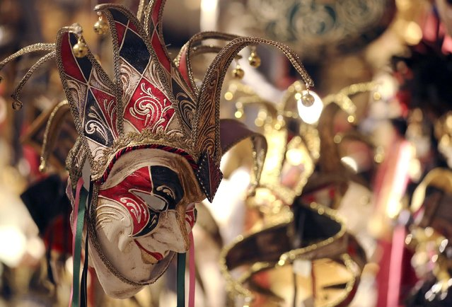 "A carnival mask is pictured in the ""Ca' del Sol"" artisan shop near St. Mark's square during the first day of carnival in Venice February 1, 2015. (Photo by Stefano Rellandini/Reuters)"