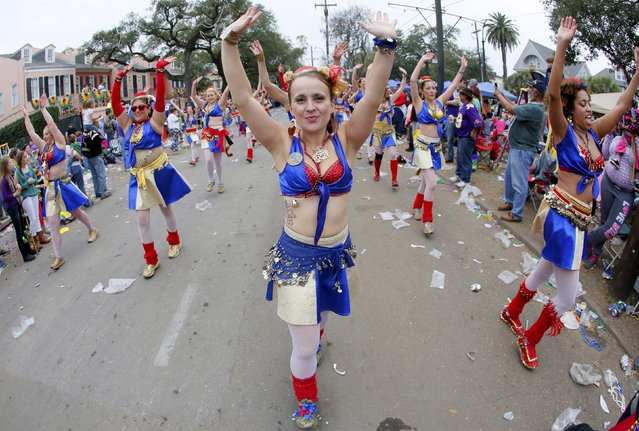 A member of the Organ Grinders dances her way down St. Charles Avenue during a Mardi Gras parade in New Orleans, Louisiana February 15, 2015. (Photo by Jonathan Bachman/Reuters)