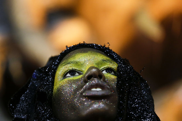 A performer from the Sao Clemente samba school, parades during Carnival celebrations at the Sambadrome in Rio de Janeiro, Brazil, Monday, February 17, 2015. (Photo by Felipe Dana/AP Photo)