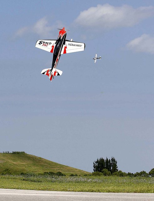 A 1/4 scale Decathlon remote control gas powered plane does a stall maneuver while another planes flies in the background. (Photo by Bill Ingram/The Palm Beach Post)