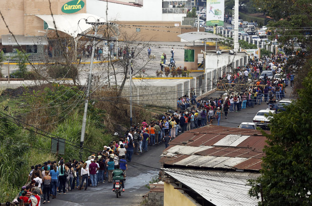 People line up to buy food at a supermarket in San Cristobal, southwest of Caracas, February 27, 2014. (Photo by Carlos Garcia Rawlins/Reuters)