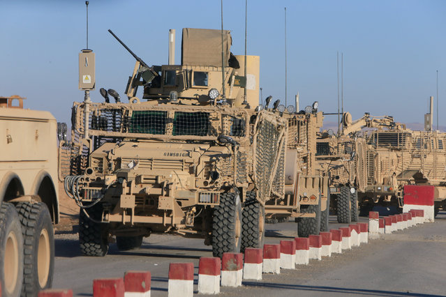 American vehicles drive on the outskirts of Qayyara, Iraq December 6, 2016. (Photo by Alaa Al-Marjani/Reuters)