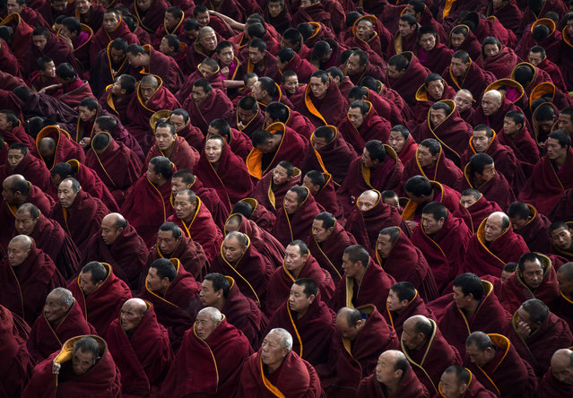 Tibetan Buddhist monks take part in a special prayer during Monlam or the Great Prayer rituals on March 5, 2015 at the Labrang Monastery, Xiahe County, Amdo, Tibetan Autonomous Prefecture, Gansu Province, China. (Photo by Kevin Frayer/Getty Images)