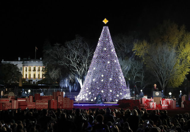President Barack Obama speaks during the lighting ceremony for the 2016 National Christmas Tree is seen before the lighting ceremony on the Ellipse near the White House, Thursday, December 1, 2016 in Washington. (Photo by Alex Brandon/AP Photo)