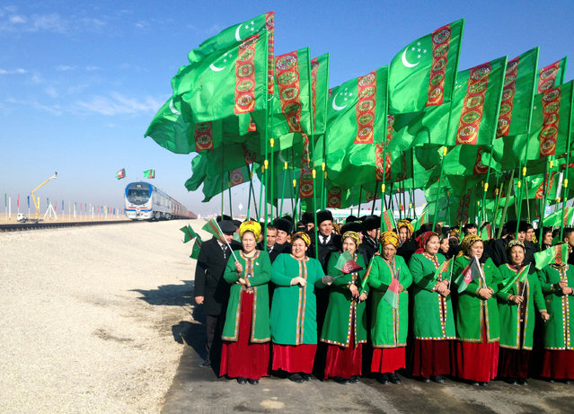 TURKMENISTAN: People attend the opening ceremony of a railway link to Afghanistan in the Ymamnazar customs control point, Turkmenistan, November 28, 2016. (Photo by Marat Gurt/Reuters)