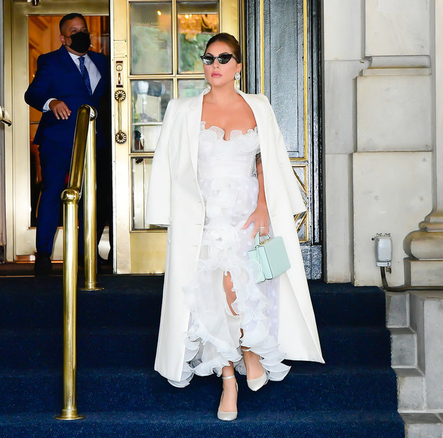 Lady Gaga makes a stylish exit from her hotel in New York City on July 1, 2021. The 35 year old singer and actress wore a white trench over-the-shoulders, white tulle dress, and matching heels. (Photo by The Image Direct)