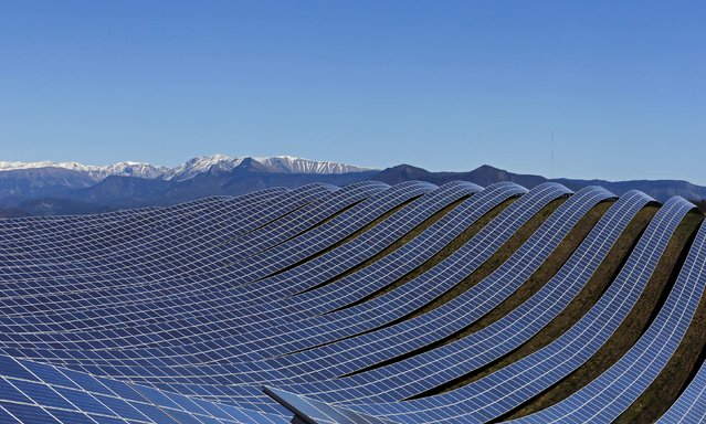 A general view shows solar panels to produce renewable energy at the photovoltaic park in Les Mees, in the department of Alpes-de-Haute-Provence, southern France March 31, 2015. The solar farm of the Colle des Mees, the biggest in France, consists of 112,780 solar modules covering an area of 200 hectares of land and representing 100 MW of power. (Photo by Jean-Paul Pelissier/Reuters)