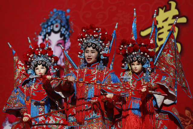 A Chinese dancer dressed in the traditional costume performs a cultural dance on stage during a temple fair for a Lunar New Year celebration in Beijing, Monday, February 8, 2016. Millions of Chinese began celebrating the Lunar New Year, which marks the Year of the Monkey on the Chinese zodiac. (Photo by Andy Wong/AP Photo)