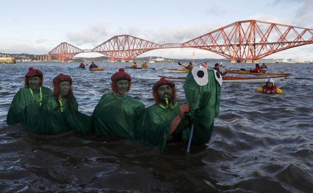 Swimmers in fancy dress participate in the New Year's Day Loony Dook swim at South Queensferry in Scotland, Britain, January 1, 2017. (Photo by Russell Cheyne/Reuters)