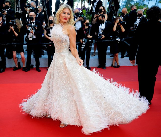 """Israeli socialite and TV host Hofit Golan arrives for the screening of the film """"Tre Piani"""" (Three Floors) at the 74th edition of the Cannes Film Festival in Cannes, southern France, on July 11, 2021Israeli socialite and tv host Hofit Golan arrives for the screening of the film """"Tre Piani"""" (Three Floors) at the 74th edition of the Cannes Film Festival in Cannes, southern France, on July 11, 2021"""