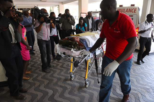 Medics help an injured person at Kenyatta National  Hospital in Nairobi, Kenya, Thursday, April 2, 2015,  after being airlifted from Garissa after an attack by gunmen at Garissa University College in northeastern Kenya on Thursday morning. Witnesses say the gunmen who stormed a college in Kenya Thursday morning identified themselves as members of al-Shabab, the Islamic extremist group from neighboring Somalia. (Photo by AP Photo/Stringer)