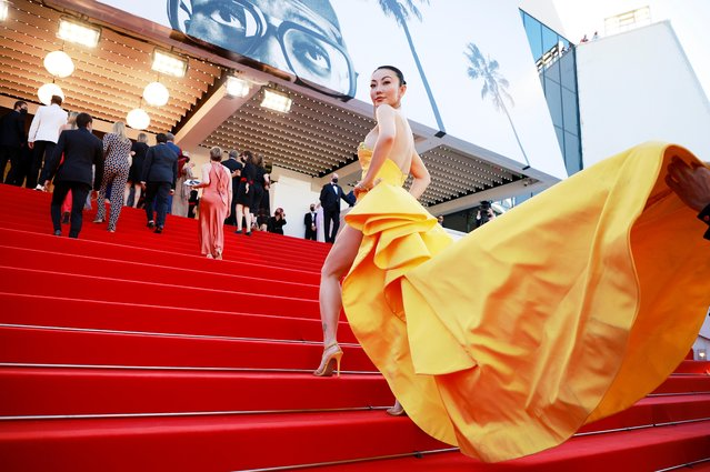 """Chinese US fashion blogger Jessica Wang poses for photographers upon arrival at the premiere of the film """"Aline"""" at the 74th international film festival, Cannes, southern France, Tuesday, July 13, 2021. (Photo by Sarah Meyssonnier/Reuters)"""