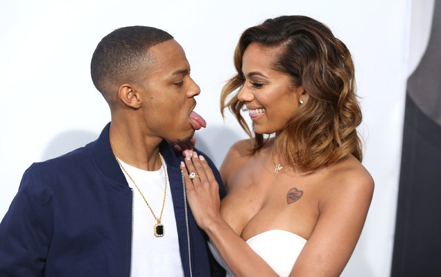 """Shad Moss, left, and Erica Mena arrive at the premiere of """"Furious 7"""" at the TCL Chinese Theatre IMAX on Wednesday, April 1, 2015, in Los Angeles. (Photo by Matt Sayles/Invision/AP Photo)"""