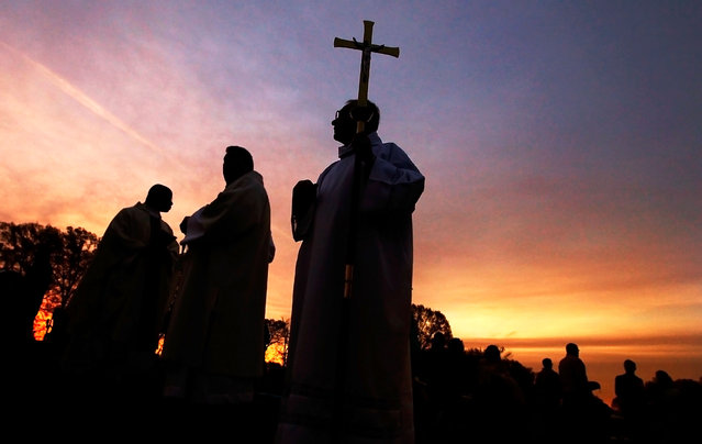 Bubba McArthur, center, waits with members of the clergy as they prepare for the opening processional during the 30th annual Easter Sunrise Mass at Calvary Cemetery, Sunday, April 5, 2015, in Memphis, Tenn. (Photo by Jim Weber/AP Photo/The Commercial Appeal)