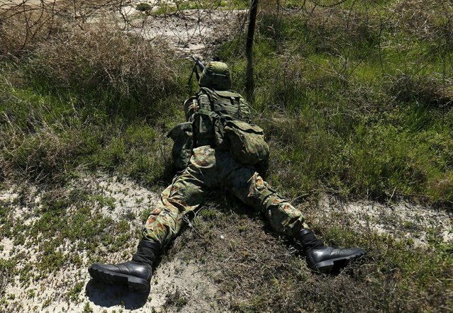 A soldier from Japan's Ground Self Defense Force takes up a defensive position as he trains alongside U.S. Marines during the bilateral annual Iron Fist military training exercise in Camp Pendleton, California February 26, 2016. (Photo by Mike Blake/Reuters)