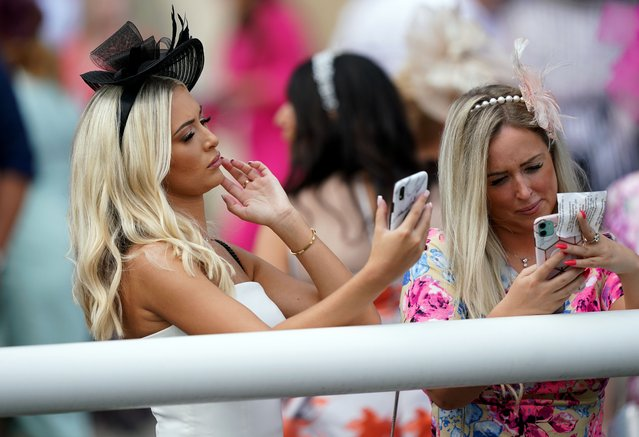 Racegoers on Ladies Day of the Cazoo St Leger Festival at Doncaster racecourse in United Kingdom on Thursday, September 9, 2021. (Photo by Mike Egerton/PA Images via Getty Images)