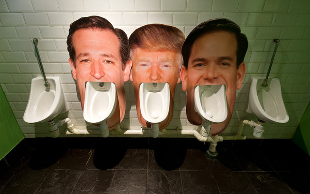 Cardboard cut outs of the faces of three candidates for the Republican nomination for the 2016 US Presidential election (L-R) Ted Cruz, Donald Trump and Marco Rubio, are seen set up on urinals in a pub in London on March 1, 2016 as part of an informal poll for customers to log which they dislike the most. Part of the satirical television show The Last Leg, customers at the pub are able to choose which urinal to use and then log their poll on a list on the wall afterwards. (Photo by Justin Tallis/AFP Photo)
