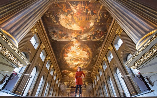 A gallery assistant poses in The Painted Hall, which has been restored as part of a conservation project, at the Old Royal Naval College in Greenwich in London on March 20, 2019. The 4000 square meter baroque Painted Hall was previously used as a dining room and has been restored as part of an almost £8.5 million conservation project and will open to the public on March 23, 2019. (Photo by Dominic Lipinski/PA Wire Press Association)