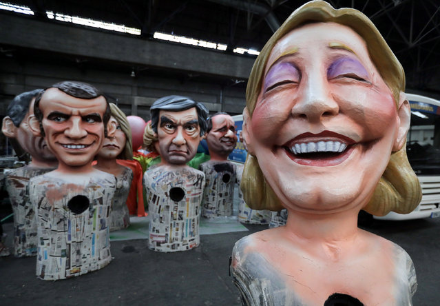 Giant figures of (L-R) Emmanuel Macron, head of the political movement En Marche !, or Onwards !, and candidate for the 2017 presidential election, Francois Fillon, former French prime minister, member of The Republicans political party and 2017 presidential candidate of the French centre-right, and French National Front leader Marine Le Pen, are seen during preparations for the carnival parade in Nice, France, February 2, 2017. (Photo by Eric Gaillard/Reuters)