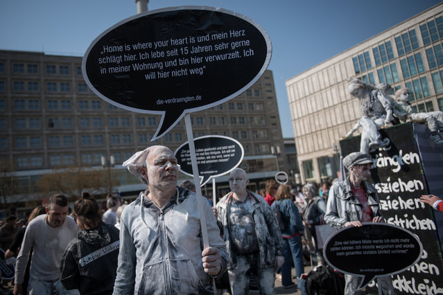 Demonstrators gather at Alexanderplatz to protest against rising rents and an ever-tightening Berlin housing market on April 6, 2019 in Berlin, Germany. Berlin has seen a strong surge in both real estate development and population growth over the last decade that is transforming its housing market. While the city was once known for cheap rents, today housing has become scarce and expensive. Protesters are focusing their anger especially against developer Deutsche Wohnen, a company backed by U.S. investor Blackrock, that has bought up over 100,000 apartments in Berlin. Critics charge Deutsche Wohnen with drastically raising rents and neglecting its property maintenance responsibilities. (Photo by Steffi Loos/Getty Images)
