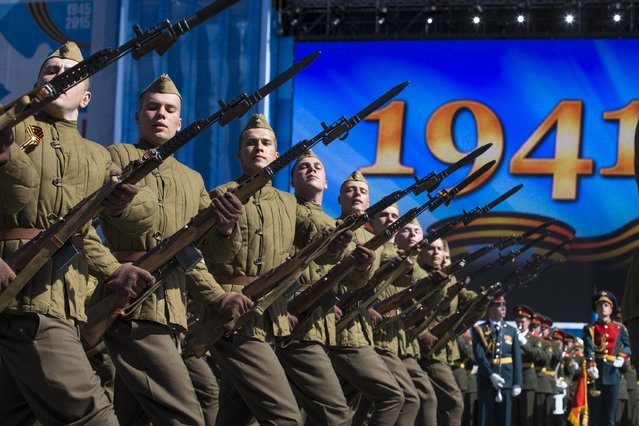 Russian army soldiers, dressed in WWII era uniforms, march along the Red Square during a general rehearsal for the Victory Day military parade which will take place at Moscow's Red Square on May 9 to celebrate 70 years after the victory in WWII, in Moscow, Russia, Thursday, May 7, 2015. (Photo by Alexander Zemlianichenko/AP Photo)
