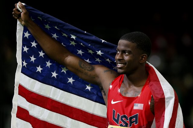 Trayvon Bromell of the U.S. celebrates with an American flag after winning the gold medal in the men's 60 meters at the IAAF World Indoor Athletics Championships in Portland, Oregon March 18, 2016. (Photo by Lucy Nicholson/Reuters)