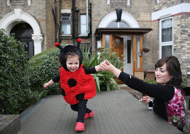 A woman holds a young girl as she dances during celebrations for the Jewish festival of Purim in Stamford Hill in north London, Britain March 24, 2016. (Photo by Neil Hall/Reuters)