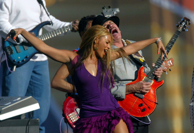 """In this January 26, 2003, file photo, Beyonce and guitarist Carlos Santana perform for the pre-game show before the start of Super Bowl XXXVII in San Diego. Santana said on Facebook February 14, 2017, that he was only trying to congratulate Adele on her big night at the Grammys when he told the Australian Associated Press that Beyonce """"is very beautiful to look at"""", but """"she's not a singer, singer."""" (Photo by Lawrence Jackson/AP Photo)"""
