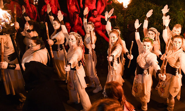 Beltane Fire Society performers celebrate the coming of summer by participating in the Beltane Fire Festival on Calton Hill April 30, 2019 in Edinburgh, Scotland. The event celebrates the ending of winter and is a revival of the ancient Celtic and Pagan festival of Beltane, the Gaelic name for the month of May. This years festival was highlighting climate change, with the central character The May Queen being seen to express her rage at the damage done to Earth. (Photo by Jeff J. Mitchell/Getty Images)
