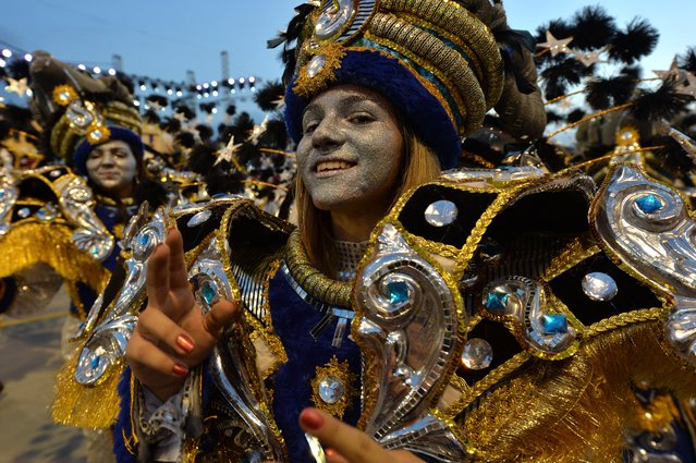 Revelers of the Academicos do Tatuape samba school perform during the second night of carnival parade at the Sambadrome in Sao Paulo, Brazil on March 2, 2014. (Photo by Nelson Almeida/AFP Photo)