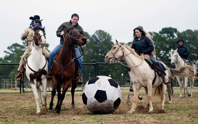 Brenda Jones of Maydelle, Justin Reeves of Longview and Kathy Hawkins of Diana play in a male versus female game of Cowboy Mounted Soccer at the 1836 Chuckwagon Race Festival held at Diamond B Ranch in Neches, Texas, on March 5, 2014. The event celebrates Texas Independence Day. (Photo by Sarah A. Miller/Tyler Morning Telegraph)