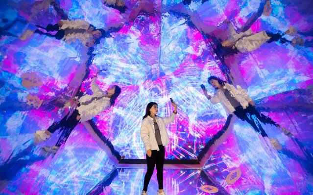 """A visitor takes selfies in the """"Kaleidoscope"""" installation at an experience centre on May 27, 2019 in Hohhot, Inner Mongolia Autonomous Region of China. (Photo by Ding Genhou/VCG via Getty Images)"""