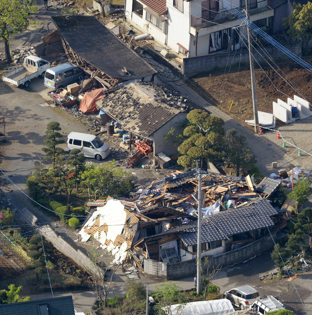 This aerial photo shows houses damaged by a magnitude-6.5 earthquake in Mashiki, Kumamoto prefecture, southern Japan, Friday, April 15, 2016. (Photo by Sadayuki Goto/Kyodo News via AP Photo)
