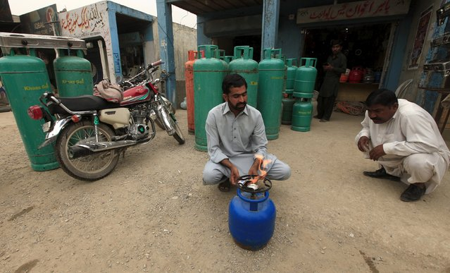 A man sells Liquified Petroleum Gas (LPG) in Islamabad, Pakistan April 29, 2015. (Photo by Faisal Mahmood/Reuters)