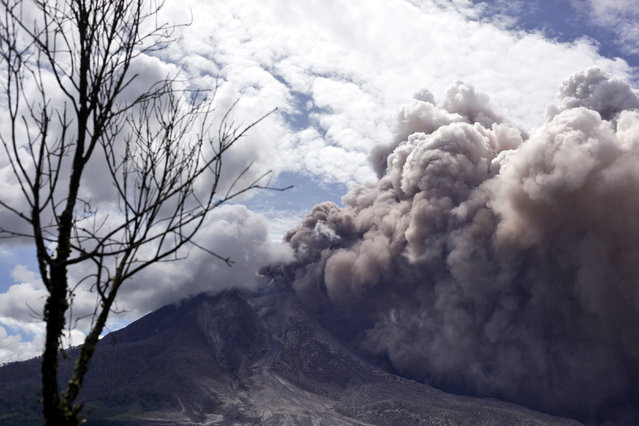 Mount Sinabung releases pyroclastic flows as seen from Tiga Pancur, North Sumatra, Indonesia, Saturday, June 13, 2015. The volcano, which was put on it highest alert level last week, has sporadically erupted since 2010 after being dormant for 400 years. (AP Photo/Binsar Bakkara)