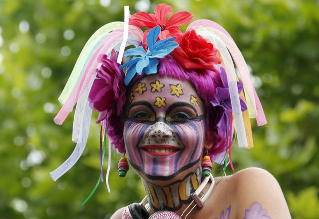 A participant smiles at the annual Christopher Street Day parade on Kurfuerstendamm in Berlin, Germany, June 27, 2015. (Photo by Fabrizio Bensch/Reuters)