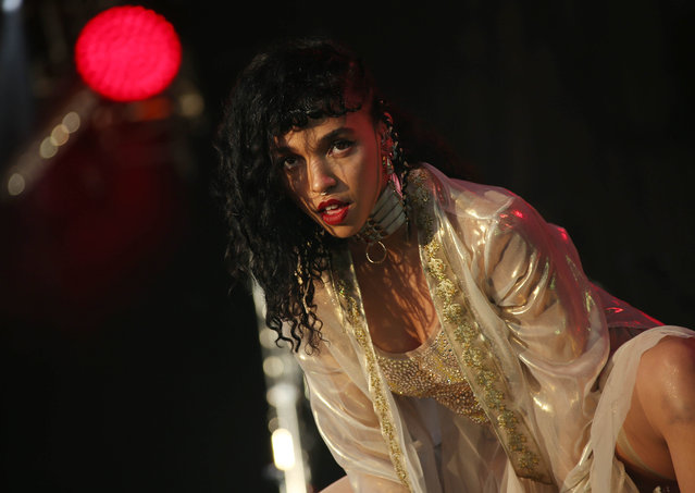Tahliah Barnett, known as FKA Twigs, performs on the West Holts stage at Glastonbury music festival at Worthy Farm, Glastonbury, England, Sunday, June 28, 2015. (Photo by Joel Ryan/Invision/AP Photo)