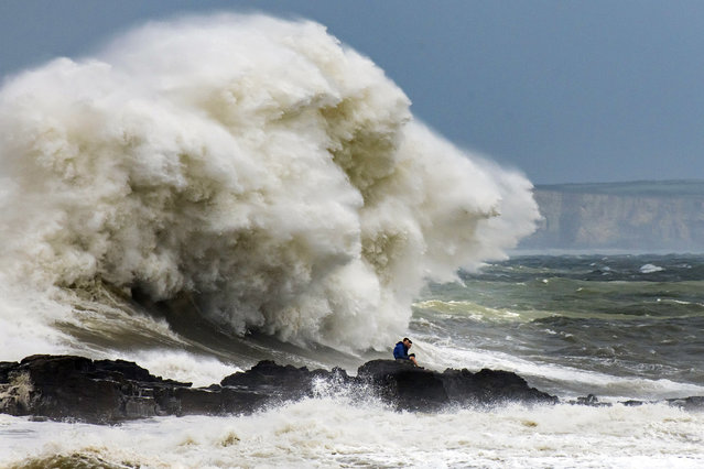 Waves crash against the harbour wall on August 10, 2019 in Porthcawl, Wales. The Met Office have issued a yellow weather warnings for winds of up to 60mph and thunderstorms for large parts of the UK. (Photo by Matthew Horwood/Getty Images)