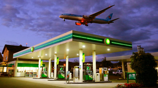 An aircraft of Korean Airlines is seen above a BP petrol station approaching to land at Zurich Airport in Kloten, Switzerland October 3, 2017. (Photo by Arnd Wiegmann/Reuters)