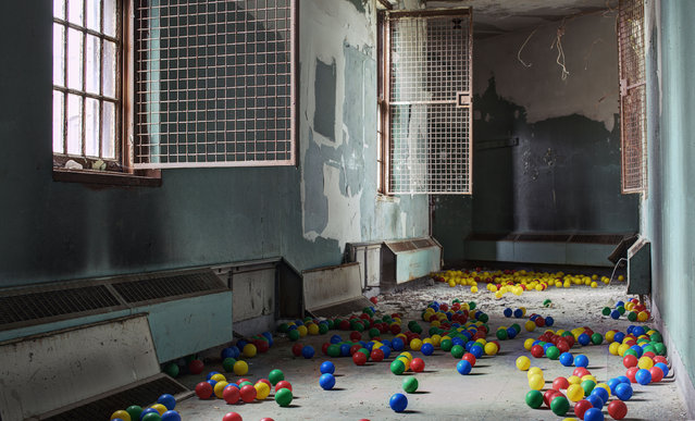 Plastic balls cover the floor of an abandoned asylum, New York. (Photo by Daniel Barter/Caters News)