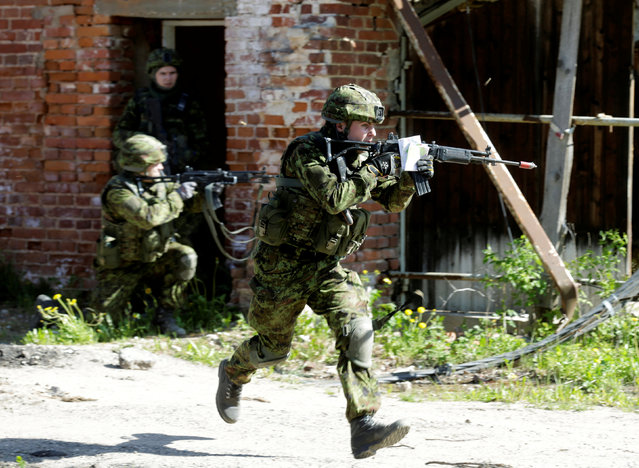 Estonian army soldiers train for urban fighting during the Spring Storm military exercise near the country's eastern border in Rapina, Estonia May 13, 2016. (Photo by Ints Kalnins/Reuters)