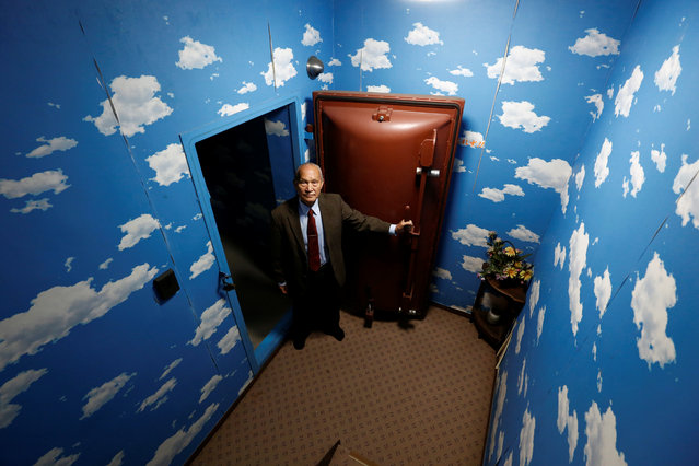 Seiichiro Nishimoto, CEO of Shelter Co., poses in front of a blast door at the entrance of a model room for his company's nuclear shelters during an interview with Reuters in Osaka, Japan on April 26, 2017. (Photo by Kim Kyung-Hoon/Reuters)