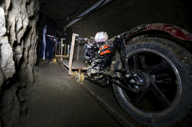 "A motorcycle modified to run on rails is seen inside a tunnel connected to the Altiplano Federal Penitentiary and used by drug lord Joaquin ""El Chapo"" Guzman to escape, in Almoloya de Juarez, on the outskirts of Mexico City, July 15, 2015. (Photo by Edgard Garrido/Reuters)"