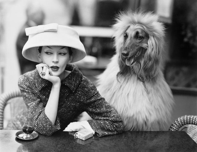 The model Dovima in a suit and cloche hat at Les Deux Magots cafe in Paris, France in 1955. (Photo by Richard Avedon/The Richard Avedon Foundation/The Guardian)
