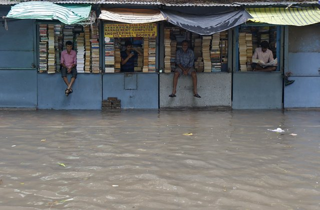 Book sellers wait for customers inside their flooded shops after heavy rainfall in Kolkata, India, July 10, 2015. After drenching India with above-average rains in June, the monsoon has weakened in what is typically the wettest and most crucial month for millions of farmers growing oilseeds, rice, cotton and pulses. Good rainfall this year is key to boosting a rural economy hit by delayed and lower rains last year, as well as keeping a lid on food inflation and giving India's central bank more scope to cut lending rates. (Photo by Rupak De Chowdhuri/Reuters)
