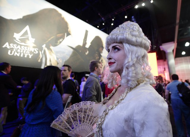 "A woman dressed as Marie Antoinette from the video game ""Assassin's Creed: Unity"" promotes the game in the Ubisoft booth at the 2014 Electronic Entertainment Expo, known as E3, in Los Angeles, June 10, 2014.  REUTERS/Kevork Djansezian"
