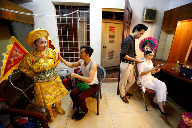 Vietnamese mediums get ready for a performance at a theatre in Hanoi, Vietnam, May 7, 2017. (Photo by Reuters/Kham)